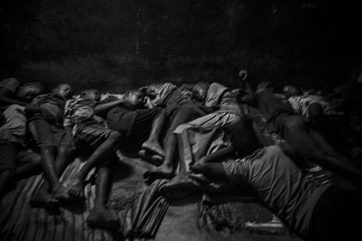 Talibes sleep together inside a daara in Saint Louis, north of Senegal, May 21, 2015. The daara with over 30 children has no clean water and barely no electricity. Children sleep on the concrete floor without any protection.